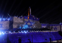 Israel national flag is projected on the wall near David Tower at the Old City of Jerusalem.