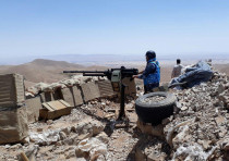 Fighters from the Syrian army units and Hezbollah are seen on the western mountains of Qalamoun, nea