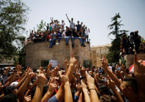Palestinians celebrate outside Temple Mount in Jerusalem