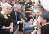 Israeli Prime Minister Benjamin Netanyahu speaks to the family members of the three people killed by