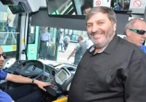 KKL-JNF World Chairman Danny Atar boards an electric bus in Haifa