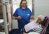 A patient recieves free dentures from Dental Volunteers for Israel