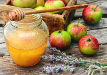 Apples and honey. Fragrant summer apples and jar of honey