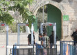 BOYS PASS THROUGH metal detectors just inside the Old City's Lions' Gate.