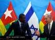 Israeli Prime Minister Benjamin Netanyahu (R) speaks with Togo's President Faure Gnassingbe during a