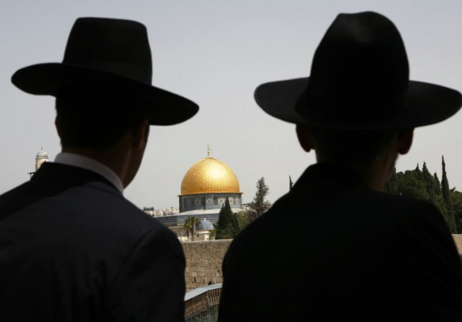 Ultra-Orthodox Jews look towards the Dome of the Rock in Jerusalem's Old City