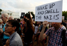 People gather for a vigil in response to the death of a counter-demonstrator at the