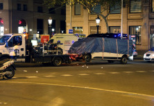 The suspected van is towed away from the area where it crashed into pedestrians at Las Ramblas.