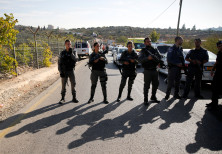 Border Police officers stand guard at the scene of the terror attack in Har Adar